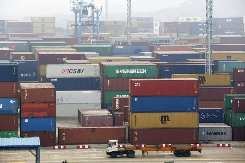 A trailer loaded with container boxes travels in Ningbo port