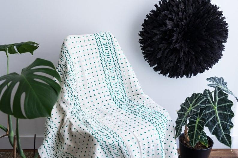 """<br> <br> <strong>AisheaHOME</strong> White and Green Cloth, $, available at <a href=""""https://go.skimresources.com/?id=30283X879131&url=https%3A%2F%2Fwww.etsy.com%2Flisting%2F806311896%2Fwhite-and-green-bogolan-mud-cloth"""" rel=""""nofollow noopener"""" target=""""_blank"""" data-ylk=""""slk:Etsy"""" class=""""link rapid-noclick-resp"""">Etsy</a>"""