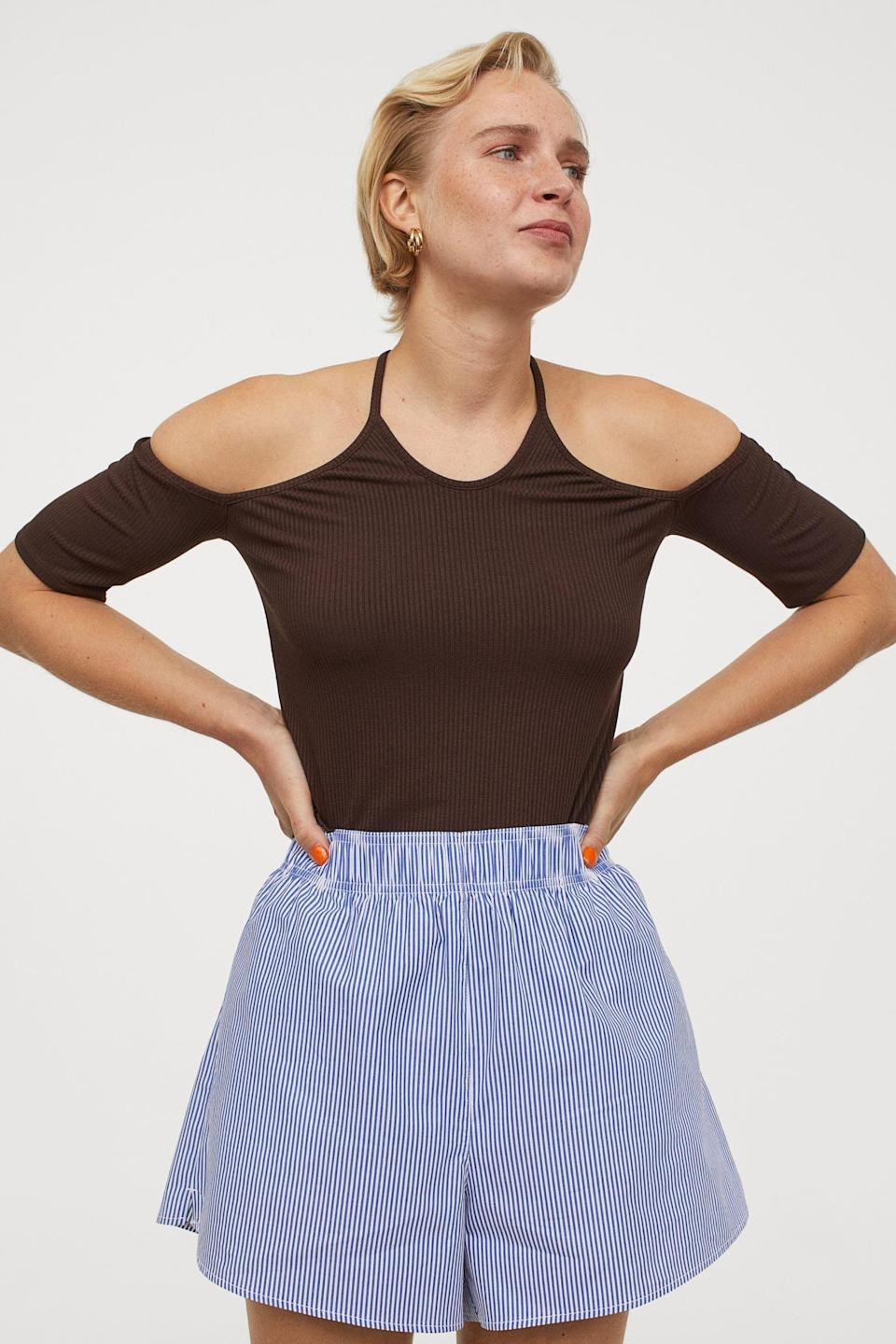 <p>Pair this <span>Ribbed Open-shoulder Top</span> ($13) with your favorite black denim cutoffs and some minimal mules.</p>