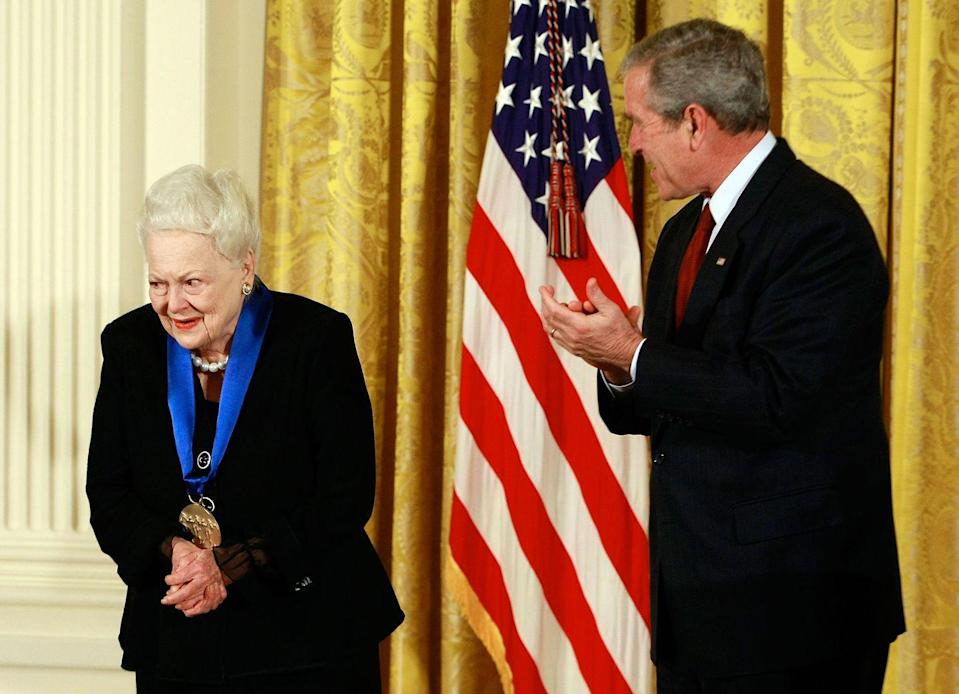 <p>With former President George W. Bush after receiving the National Medal of Arts. </p>