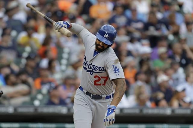 Los Angeles Dodgers' Matt Kemp throws his bat after hitting a fly ball against the Detroit Tigers in the fourth inning of a baseball game in Detroit, Wednesday, July 9, 2014. Kemp was out on the play. (AP Photo/Paul Sancya)