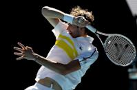 Daniil Medvedev hits a forehand on his way to beating fellow Russian Andrey Rublev in straight sets