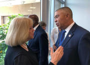 FILE - In this June 28. 2019, file photo, Rep. William Lacy Clay, right, D-Mo., speaks with St. Louis Mayor Lyda Krewson after a news conference in St. Louis. Cori Bush, a onetime homeless woman who led protests following a white police officer's fatal shooting of a Black 18-year-old in Ferguson, ousted longtime Rep. Clay on Tuesday, Aug. 4, 2020, in Missouri's Democratic primary, ending a political dynasty that has spanned more than a half-century. Bush's victory came in a rematch of 2018, when she failed to capitalize on a national Democratic wave that favored political newcomers such as Bush's friend, Rep. Alexandria Ocasio-Cortez. (AP Photo/Jim Salter, File)