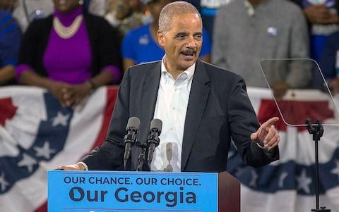 Eric Holder  - Credit: Alyssa Pointer/Atlanta Journal-Constitution via AP