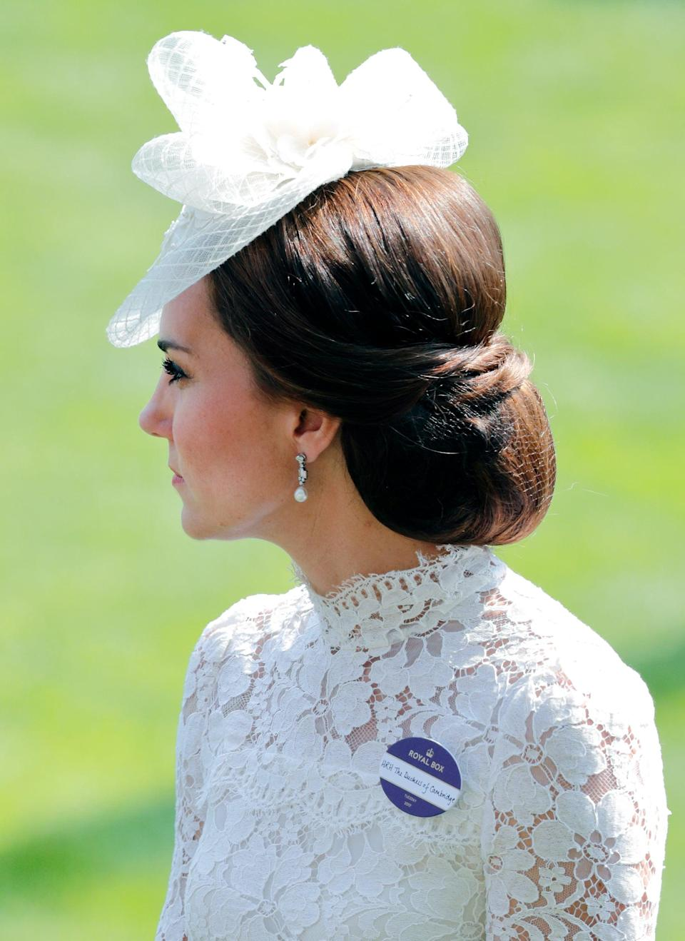 <p>Thanks to her handy hairnet, not a single hair was out of place in this looped-up chignon (with cross-cross details at the back, of course). It was the perfect style for a warm day at the Royal Ascot races in 2017. </p>