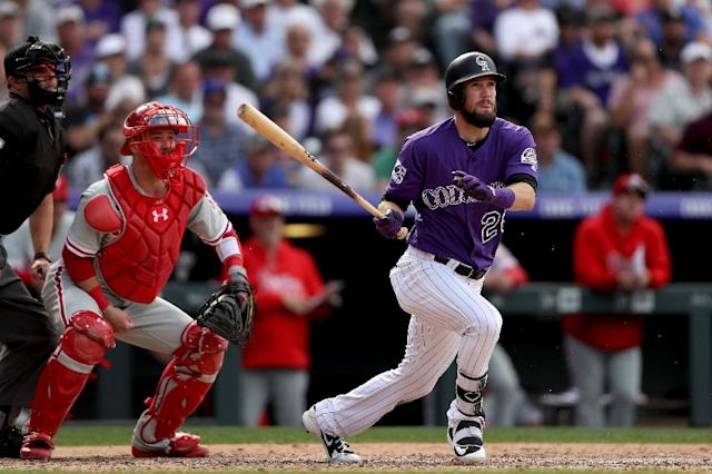David Dahl hit a homer and a run scoring triple as the Colorado Rockies are in first place in the NL West. (AFP Photo/MATTHEW STOCKMAN)