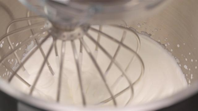 Whipping cream with balloon whisk in mixer until soft peak