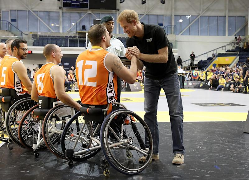 Prince Harry congratulating Invictus competitors in 2017 (Getty Images)