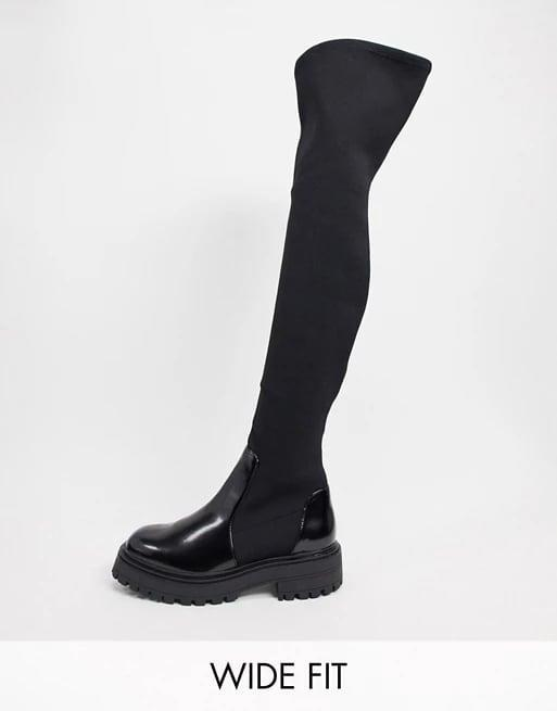 <p><span>ASOS Design Wide Fit Keeley Chunky Flat Knee Boots in Black</span> ($64)</p>