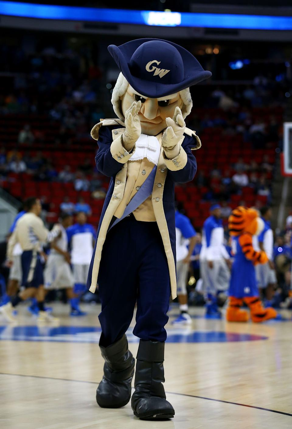 RALEIGH, NC - MARCH 21:  George Washington Colonials mascot, George, performs in the first half against the Memphis Tigers during the Second Round of the 2014 NCAA Basketball Tournament at PNC Arena on March 21, 2014 in Raleigh, North Carolina.  (Photo by Streeter Lecka/Getty Images)