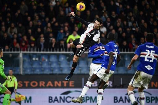 Cristiano Ronaldo leaps to head home Juventus' second in a win at Sampdoria that puts them top of Serie A