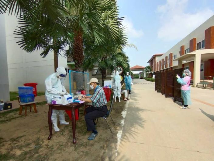 South Korean travellers take the Polymerase Chain Reaction (PCR) test, a method used to detect the coronavirus disease (COVID-19), at the Artitaya Country Club in Nakhon Nayok