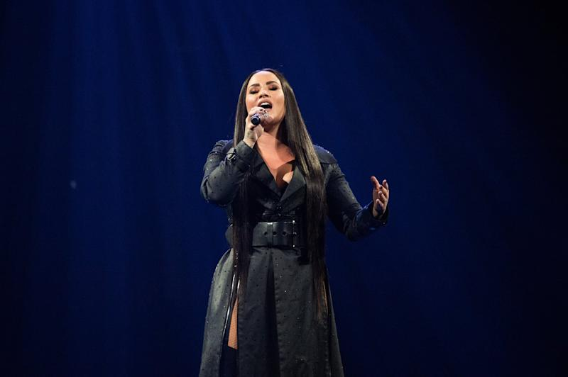 BIRMINGHAM, ENGLAND - JUNE 29: Demi Lovato performs on stage during her Tell Me That You Love Me tour at Arena Birmingham on June 29, 2018 in Birmingham, England. (Photo by Joseph Okpako/WireImage)