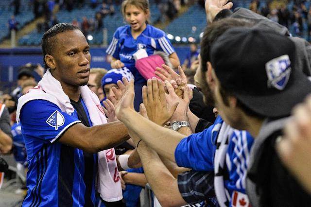 Didier Drogba of the Montreal Impact celebrates with fans during leg one of the MLS Eastern Conference finals against the Toronto FC at Olympic Stadium on November 22, 2016 (AFP Photo/Minas Panagiotakis)