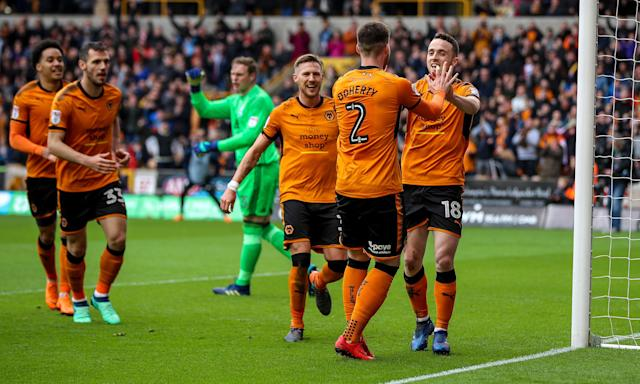 Diogo Jota (far right) celebrates scoring the opening goal for Wolves in their first match since promotion against Birmingham at Molineux.