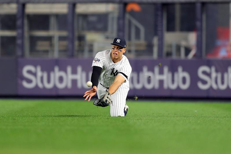 BRONX, NY - OCTOBER 04: Aaron Judge #99 of the New York Yankees dives to make the catch during the third inning of the ALDS Game 1 between the Minnesota Twins and the New York Yankees at Yankee Stadium on Friday, October 4, 2019 in the Bronx borough of New York City. (Photo by Alex Trautwig/MLB Photos via Getty Images)