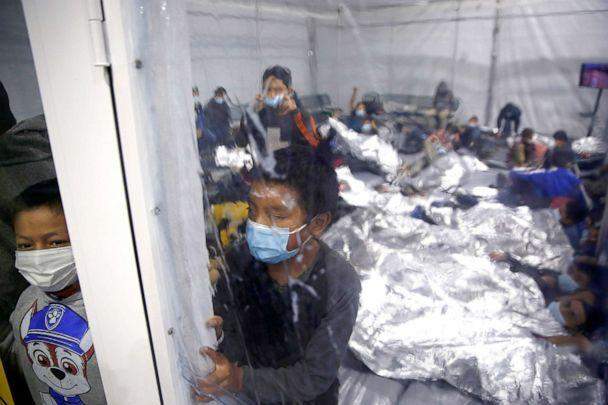 PHOTO: Children look out from inside a pod at the Donna Department of Homeland Security holding facility, the main detention center for unaccompanied children in the Rio Grande Valley, in Donna, Texas, March 30, 2021. (Dario Lopez-Mills/AP, FILE)
