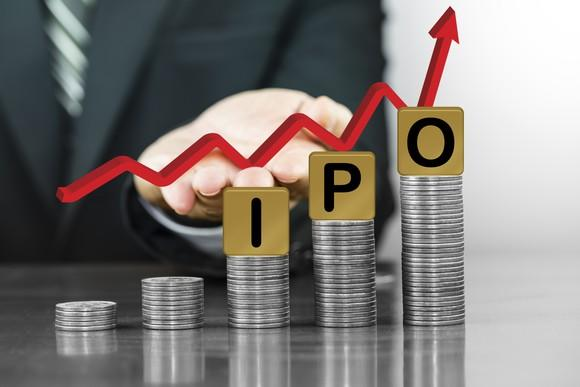 Stacks of coins with IPO on top