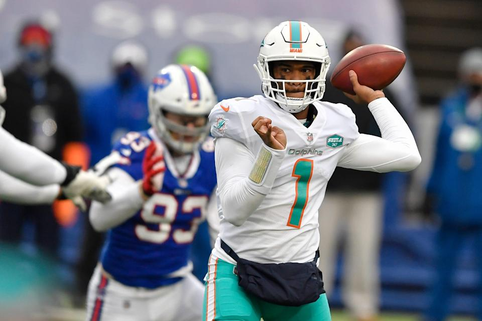 Miami Dolphins quarterback Tua Tagovailoa passes in the first half of an NFL football game against the Buffalo Bills, Sunday, Jan. 3, 2021, in Orchard Park, N.Y.