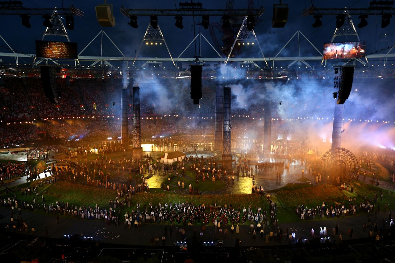 LONDON, ENGLAND - JULY 27:  A general view is seen while performers depict a view from the change of the English countryside to the Industrial Revolution during the Opening Ceremony of the London 2012 Olympic Games at the Olympic Stadium on July 27, 2012 in London, England.  (Photo by Paul Gilham/Getty Images)