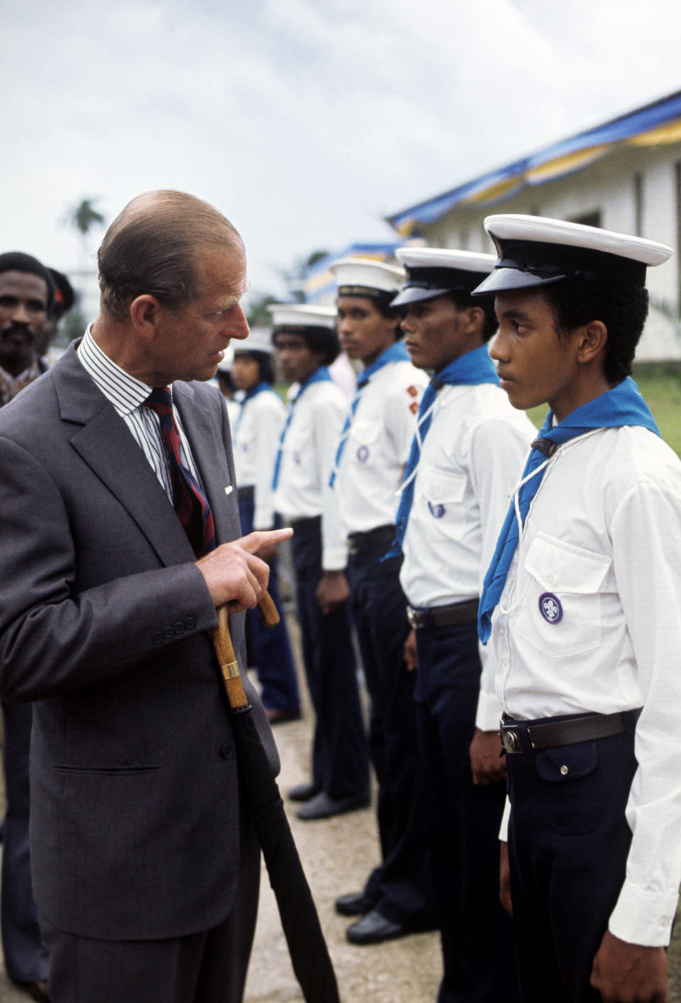 The Duke of Edinburgh talking with a sea cadet when he and Queen Elizabeth II went on a walkabout during a visit to Bridgetown, Barbados, during her Silver Jubilee tour of the Caribbean.