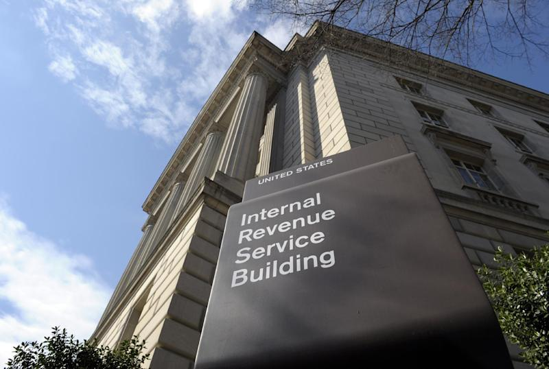 FILE - This March 22, 2013, file photo shows the exterior of the Internal Revenue Service building in Washington. Struggling to figure out your federal tax return? You're not alone, but you're in the minority. With the tax filing deadline looming on April 15, a majority of Americans say completing a federal tax return is easy, according to a new Associated Press-GfK poll.(AP Photo/Susan Walsh, File)