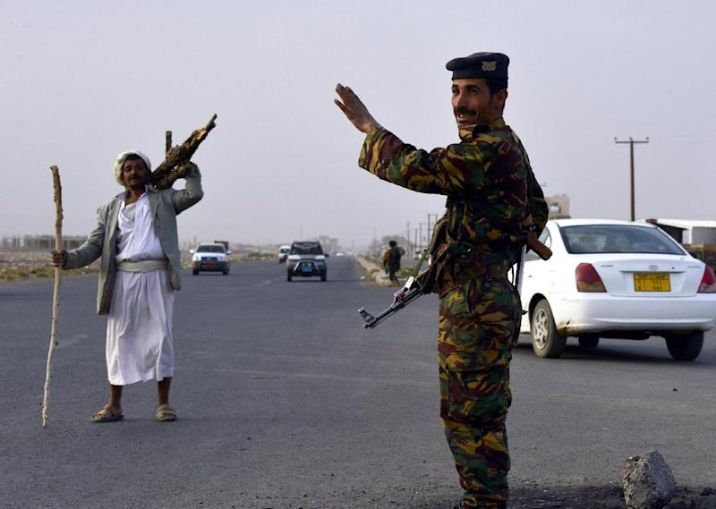 A Yemeni soldier mans a checkpoint on a road leading to the city of Amran, some 50 kilometres (30 miles) north of the capital Sanaa, on July 9, 2014