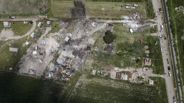 <p>Aerial view of the site of a series of explosions at fireworks warehouses in Tultepec, central Mexico, on July 5, 2018. – At least 17 people were killed, including rescue workers who died saving others' lives, officials said. The initial explosion occurred around 9:30 am (1430 GMT), then spread to other warehouses just as police and firefighters began attending to the first victims. (Photo: Pedro Pardo/AFP/Getty Images) </p>
