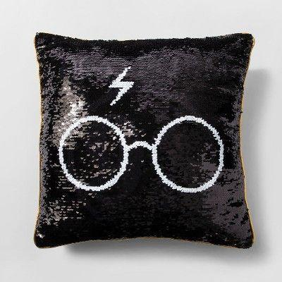 "<p><strong>Harry Potter</strong></p><p>target.com</p><p><strong>$14.99</strong></p><p><a href=""https://www.target.com/p/harry-potter-throw-pillow-black-gold/-/A-53264010"" rel=""nofollow noopener"" target=""_blank"" data-ylk=""slk:Shop Now"" class=""link rapid-noclick-resp"">Shop Now</a></p><p>This mermaid sequin pillow will add a dose of magic to any bedroom, dorm room, livingroom. </p>"