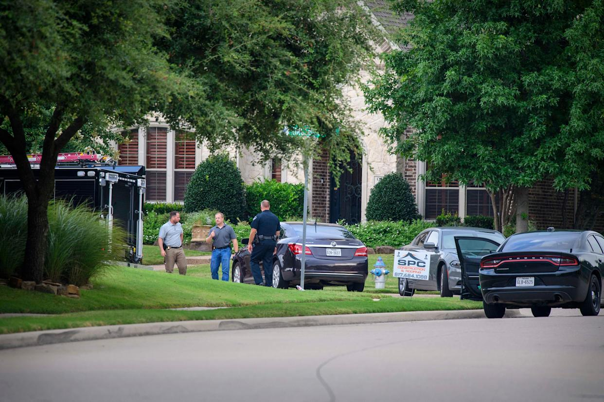 Allen, Texas, police and the FBI gather evidence from the home of Patrick Crusius, the man accused of fatally shooting 22 people at a Walmart shopping center in El Paso, Texas.