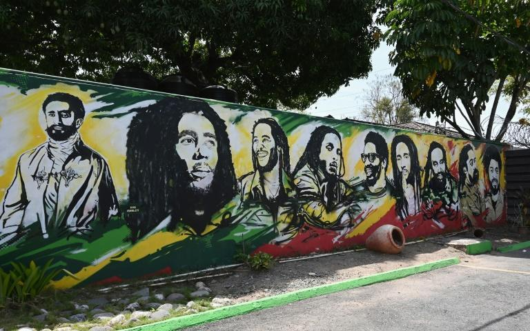 A mural depicting Ethiopian Emperor Haile Selassie I, Jamaican Reggae legend Bob Marley and his seven sons at the Bob Marley Museum in Kingston