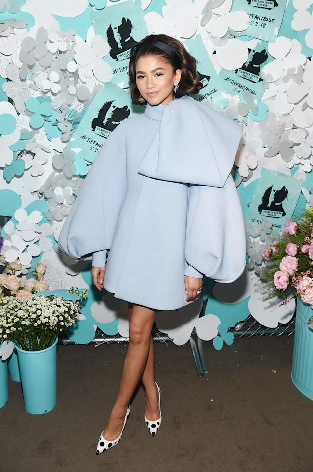 <p>For a Tiffany & Co event, Zendaya donned a powder blue dress by Dice Kayek. She teamed the '60s-inspired look with a headband and polka dot heels. <em>[Photo: Getty]</em> </p>