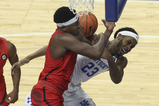 Kentucky's Isaiah Jackson (23) and Richmond's Nathan Cayo, left, battle for a rebound during the second half of an NCAA college basketball game in Lexington, Ky., Sunday, Nov. 29, 2020. (AP Photo/James Crisp)