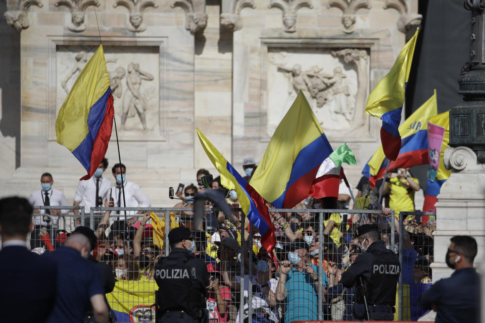 Colombian fans celebrate as Egan Bernal completes the final stage to win the Giro d'Italia cycling race, a 30.3 kilometers individual time trial from Senago to Milan, Italy, Sunday, May 30, 2021. (AP Photo/Luca Bruno)
