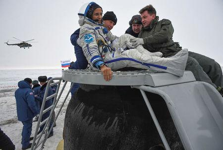 Ground personnel help astronaut Joe Acaba of the U.S. to get out of the Soyuz MS-06 space capsule after landing in a remote area outside the town of Dzhezkazgan (Zhezkazgan), Kazakhstan, on February 28, 2018.  REUTERS/Alexander Nemenov/Pool