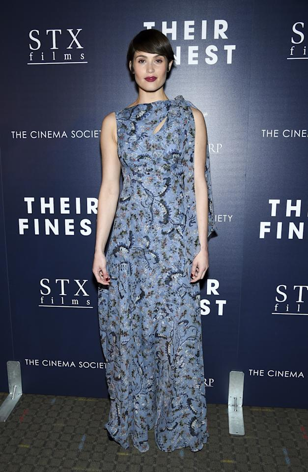 <p>Gemma's pixie cut paired perfectly with this scarf-like printed gown.<br /><i>[Photo: AP]</i> </p>