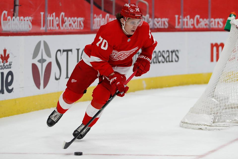 Red Wings defenseman Troy Stecher skates with the puck during the first period on Thursday, March 18, 2021, at Little Caesars Arena.