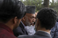 Afghanistan's former President Hamid Karzai talks with journalists after a news conference in Kabul, Afghanistan, Tuesday, July 13, 2021. Former President Karzai calls on both the Afghan government and the Taliban to resume negotiations and end fighting in the country. (AP Photo/Rahmat Gul)