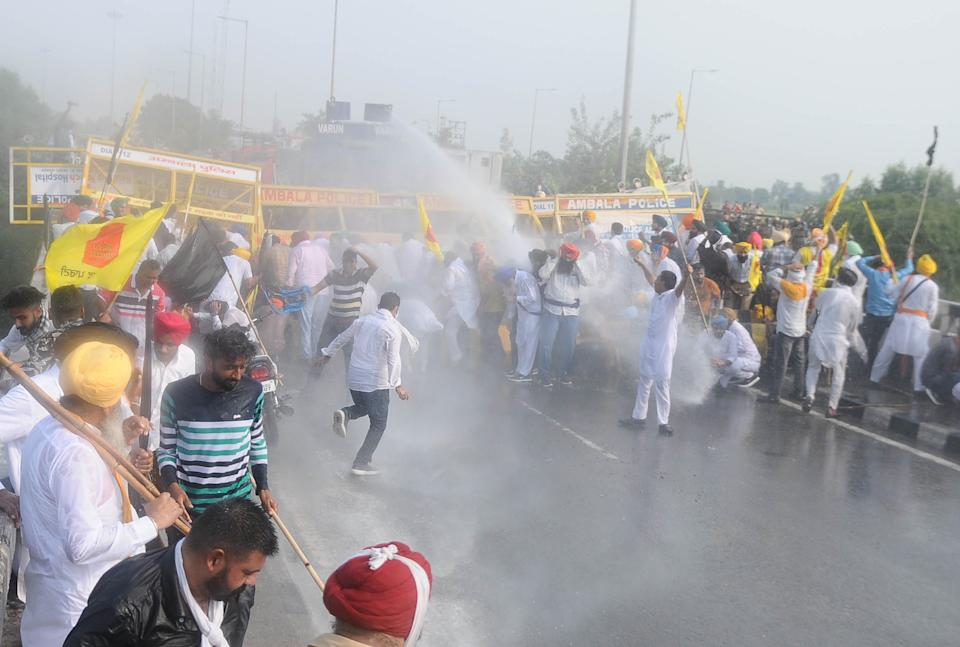 Workers of Lok Insaf Party are sprayed by a water cannon by Haryana Police during a protest against the Central government, at Punjab Haryana border on September 23, 2020 in Patiala, India. (Photo by Bharat Bhushan/Hindustan Times via Getty Images)