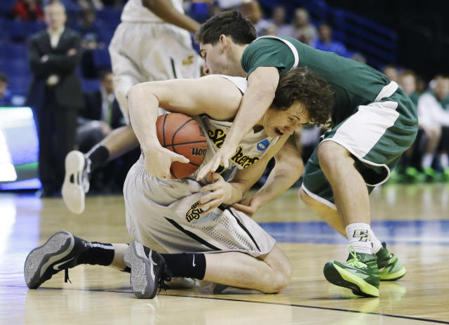 Wichita State guard Evan Wessel (3) and Cal Poly guard Ridge Shipley (10) go after the ball during the first half of a second-round game in the NCAA college basketball tournament Friday, March 21, 2014, in St. Louis. (AP Photo/Jeff Roberson)