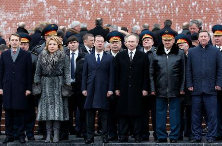FILE PHOTO: Speaker of the Russian State Duma Sergei Naryshkin, Chairwoman of the Russian Federation Council Valentina Matviyenko, Prime Minister Dmitry Medvedev, President Vladimir Putin, Defence Minister Sergei Shoigu and Chief of Staff of the Presidential Administration Sergei Ivanov (L-R) attend a wreath laying ceremony to mark the Defender of the Fatherland Day at the Tomb of the Unknown Soldier by the Kremlin wall in central Moscow, Russia February 23, 2016. REUTERS/Sergei Karpukhin/File Photo