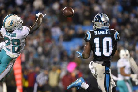Nov 13, 2017; Charlotte, NC, USA; Carolina Panthers wide receiver Curtis Samuel (10) tries to catch the ball as Miami Dolphins cornerback Bobby McCain (28) defends in the third quarter at Bank of America Stadium. Bob Donnan-USA TODAY Sports