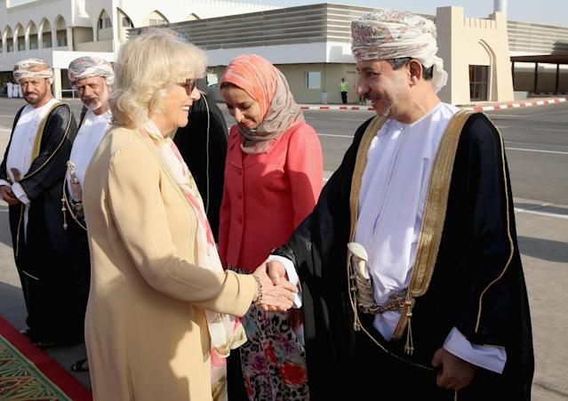 MUSCAT, OMAN - MARCH 17: Camilla, Duchess of Cornwall meets dignitaries as she arrives at Oman International Airport on the seventh day of a tour of the Middle East on March 17, 2013 in Muscat, Oman. The Royal couple are on the fourth and final leg of a tour of the Middle East taking in Jordan, Qatar, Saudia Arabia and Oman. (Photo by Chris Jackson/Getty Images)