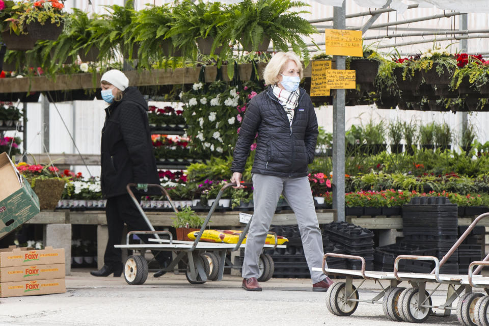TORONTO, May 4, 2020 .Customers wearing face masks do shopping at a garden center in Toronto, Canada, on May 4, 2020. Some provinces in Canada on Monday started easing some of their COVID-19 restrictions following a weekend over which thousands more cases were identified and hundreds more deaths reported. (Photo by Zou Zheng/Xinhua via Getty Images)