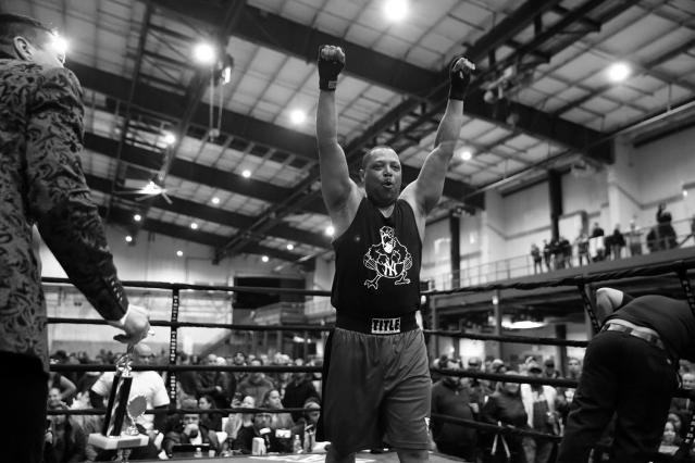 "<p>Sgt. Mark Evans celebrates his win at the ""Bronx Tough Turkey Tussle"" in the Hunts Point section of the Bronx, New York, on Nov. 16, 2017. (Photo: Gordon Donovan/Yahoo News) </p>"