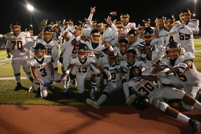 San Pedro football players celebrate after completing a 9-1 season.