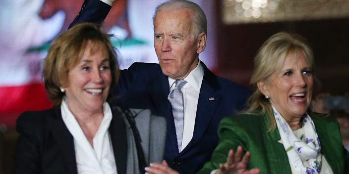 Former Vice President Joe Biden (C) arrives with wife Jill Biden (R) and sister Valerie Biden Owens (L) at a Super Tuesday campaign event at Baldwin Hills Recreation Center on March 3, 2020 in Los Angeles, California.