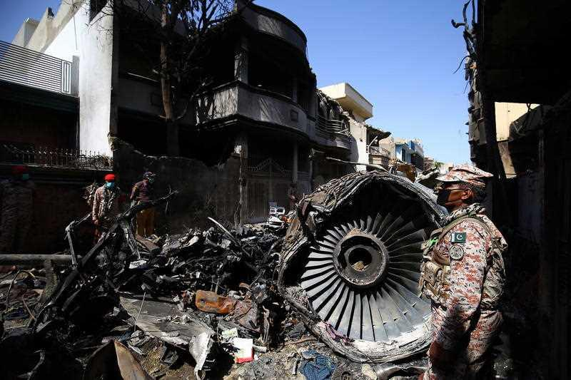 Wreckage of state run Pakistan International Airlines, Airbus A320 is lying amid houses of a residential colony days after it crashed, in Karachi, Pakistan.