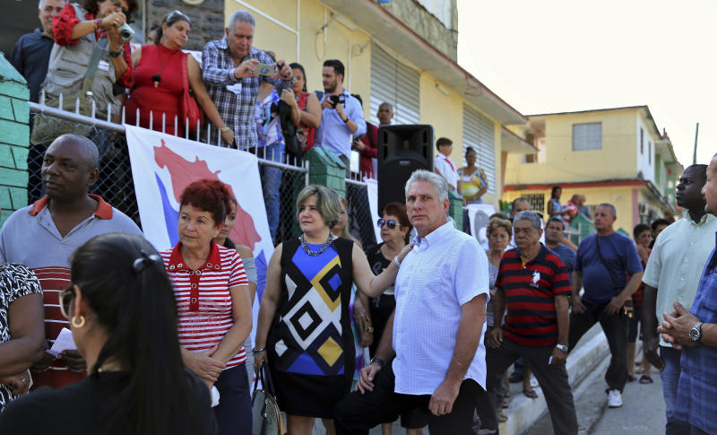 Cuba's Vice President Miguel Diaz-Canel, center right, and his wife Lis Cuesta Peraza wait in line at a voting center during elections for national and provincial representatives for the National Assembly in Santa Clara, Cuba, Sunday, March 11, 2018. (Alejandro Ernesto/Pool Photo via AP)