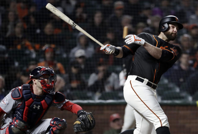 San Francisco Giants' Brandon Belt hits a double against the Washington Nationals during the fourth inning of a baseball game, Monday, April 23, 2018, in San Francisco. (AP Photo/Marcio Jose Sanchez)